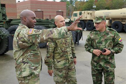 South Carolina National Guardsmen talk with an officer of the Colombian army..