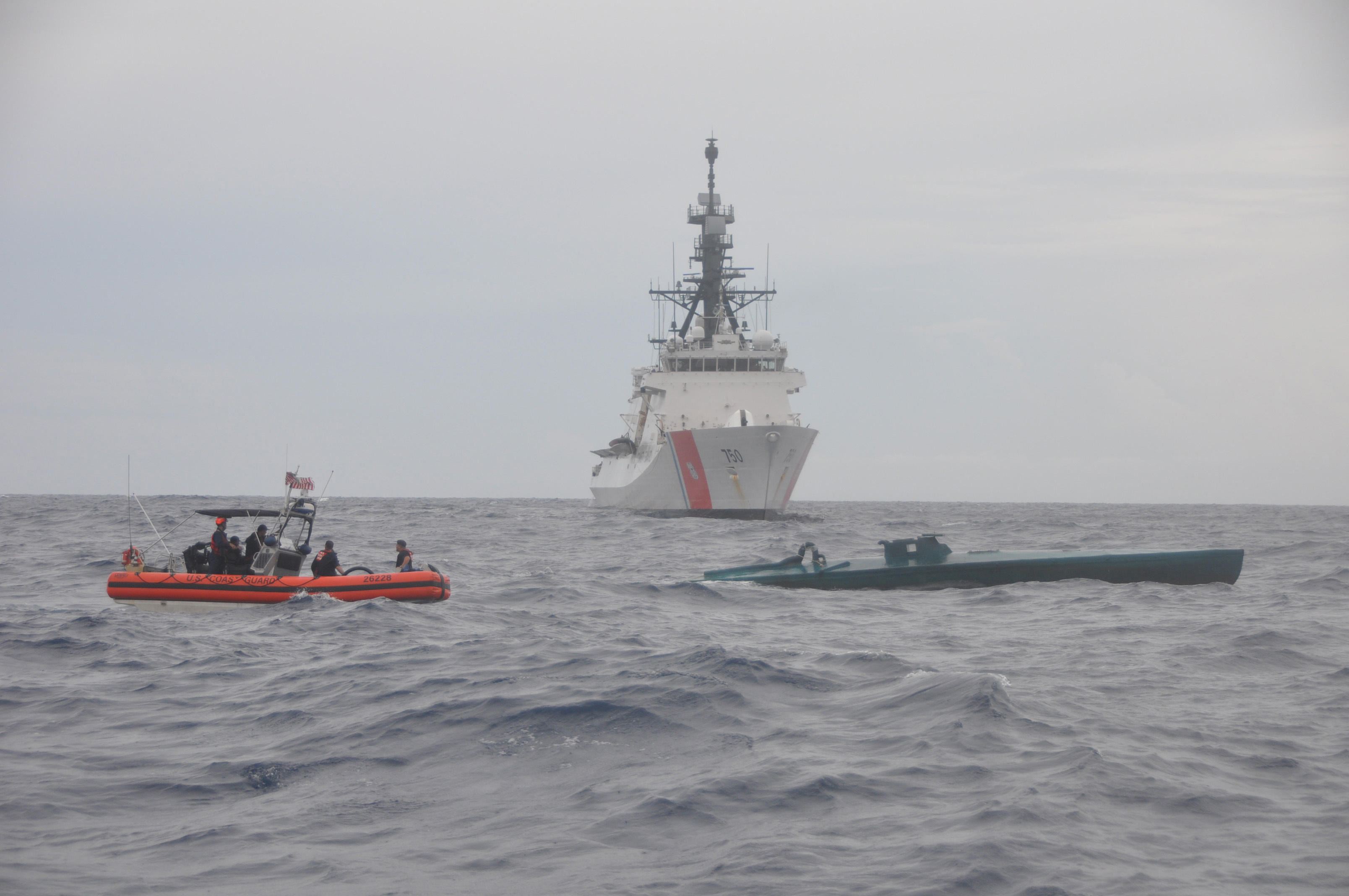 A Coast Guard Cutter Bertholf boarding team aboard an Over the Horizon Long-Range Interceptor boat conducts an interdiction of a self-propelled semi-submersible vessel suspected of smuggling 7.5 tons of cocaine in the Eastern Pacific Ocean, Aug. 31, 2015. The seized contraband is worth an estimated $227 million. (U.S. Coast Guard photo)