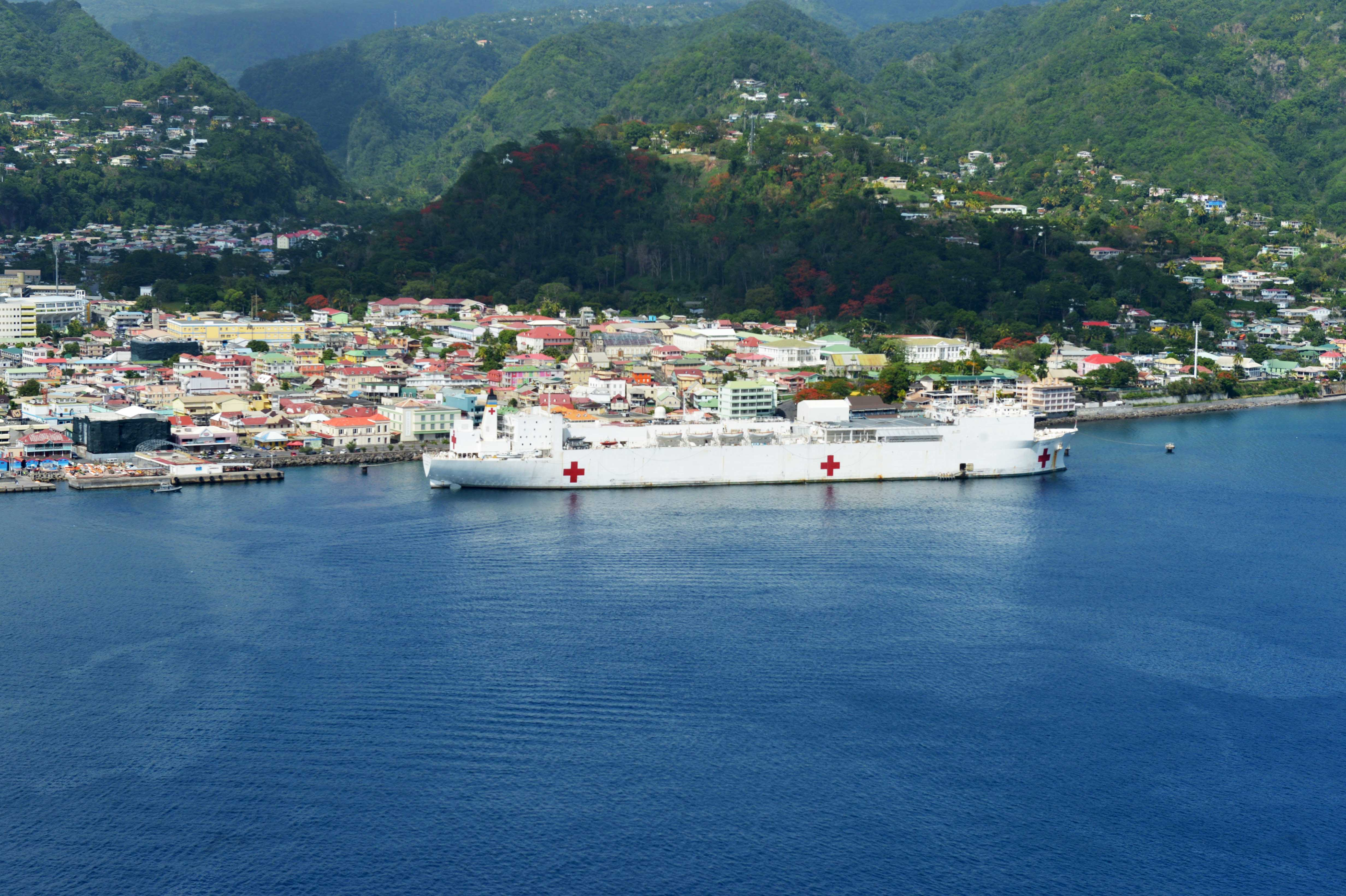 The Military Sealift Command hospital ship USNS Comfort (T-AH 20) is moored pierside in Roseau, Dominica during Continuing Promise 2015
