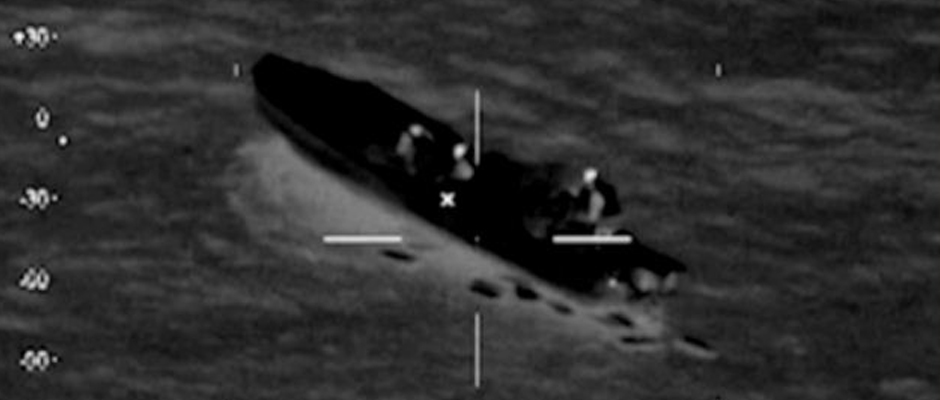 A U.S. Coast Guard HC-144 Ocean Sentry aircraft detects a 25-foot go-fast boat with four individuals and suspicious packages aboard moving at a high rate of speed south of the Dominican Republic Jan. 22 2014.