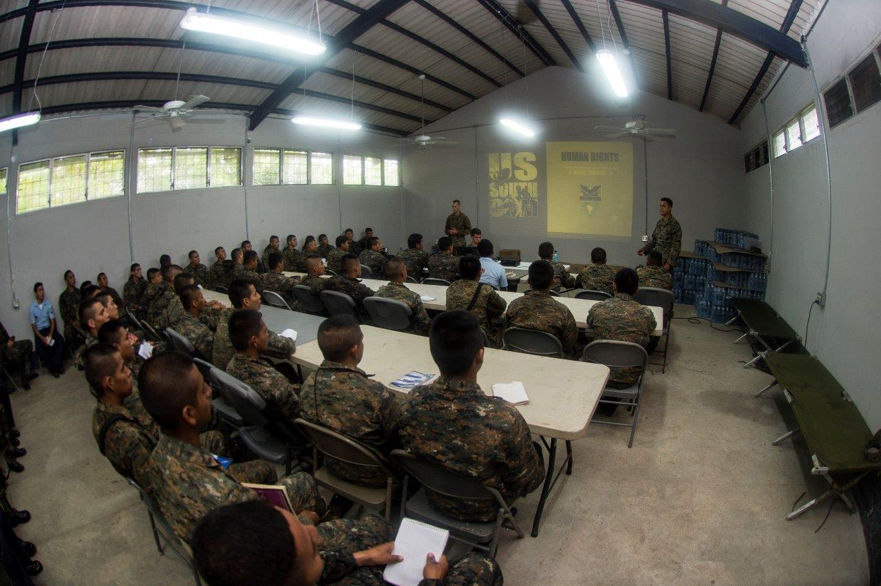 U.S. Marines assigned to a landing attack subsequent operations team lead a discussion with Guatemalan service members about human rights July 28, 2014, in Puerto Barrios, Guatemala, during Southern Partnership Station (SPS) 2014.